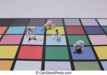 Mini people: Group of worker painting colorful paper
