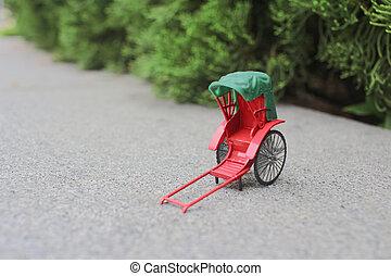 a Mini red vintage oriental rickshaw cab