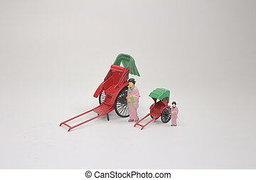 Mini statue and red vintage oriental rickshaw cab