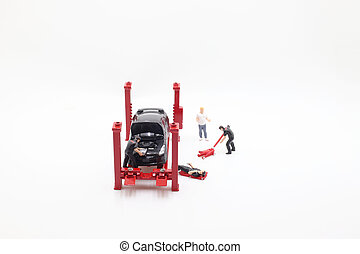 a mini Worker of a car repair