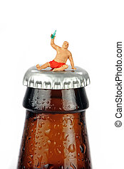 A miniature drunk man sits on top of a bottle of beer
