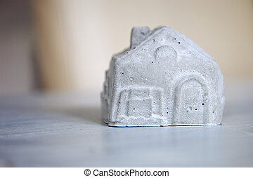 A miniature house isolated on a white background.