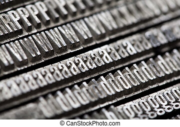 A mix of vintage letterpress characters