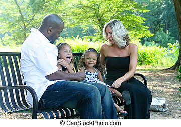 A mixed race family - A loving mixed race family enjoying...