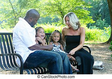 A mixed race family - A loving mixed race family enjoying...