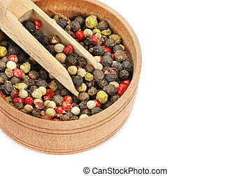 A mixture of allspice in wooden cup isolated on white background. Free space for text.