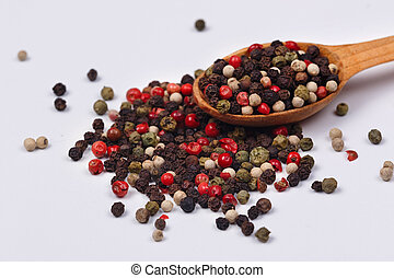 A mixture of red, black, green and white pepper