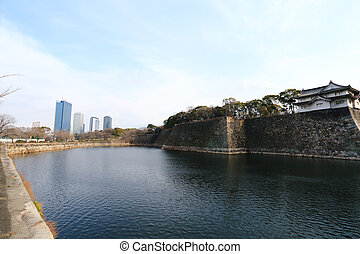 A moat surrounding Osaka castle in Japan, winter