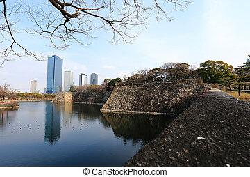 A moat surrounding Osaka castle in Japan, winter