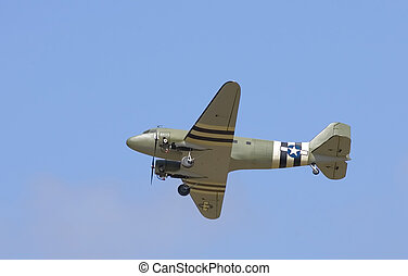 A model C-47 transport does a flyby during a practice...