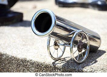 a model cannon on wheels
