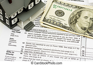 Deduct mortgage interest on taxes - A model house sitting on...