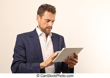 Modern business man with tablet PC