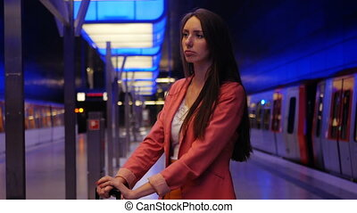 A modern business woman waiting for her train