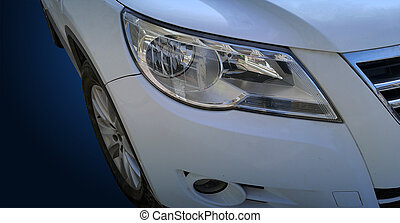 A modern car closeup of headlight on blue tone