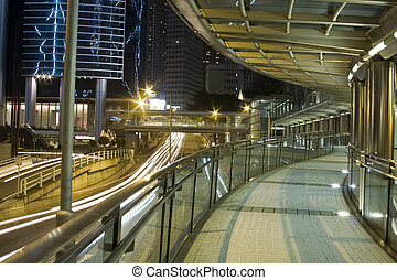 A modern flyover at night.