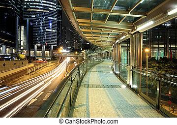 a modern footbridge at night