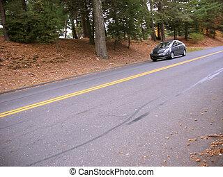 modern hybrid - A modern hybrid vehicle driving down the...