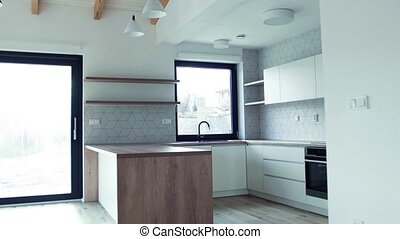 A modern interior of a kitchen in house or flat in new home...