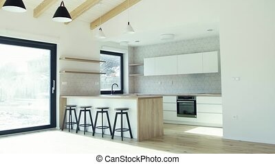 A modern interior of open space kitchen in house or flat in ...