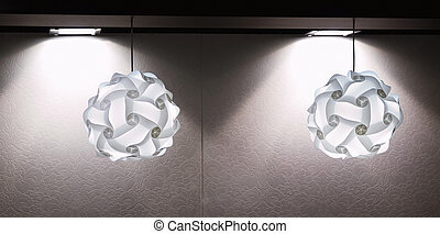 A modern lamp made out of multiple plastic diffusers