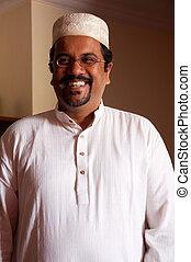 Muslim man - A modern Muslim man wearing traditional dress