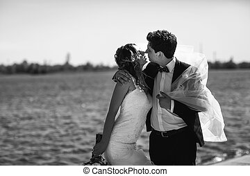A moment before a kiss between stunning newlyweds