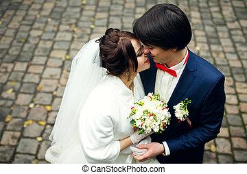 A moment before a kiss of joyful newlyweds