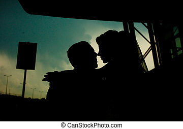 A moment before a kiss of newlyweds silhouettes