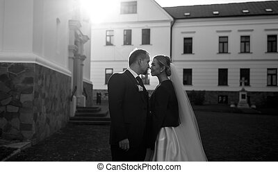 A moment before a kiss of stylish wedding couple