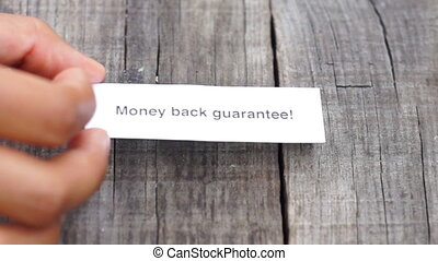 Money Back Guarantee - A Money Back Guarantee paper sign on...