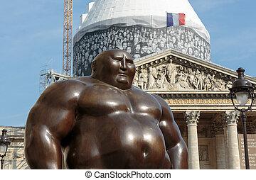 A mongolian statue in standing position by Shen Hong Biao,...