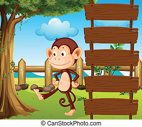 A monkey beside a wooden signage