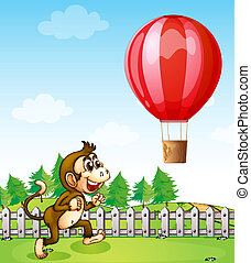 A monkey running outside the fence with a hot air balloon