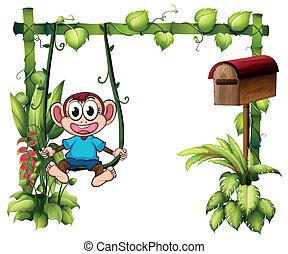 A monkey swinging beside a wooden mailbox