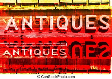 A Montage of ANTIQUES Signs Creates an Abstract Image.