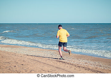 A morning jog on the ocean on a hot summer day.