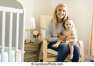 Mother and baby having good time on baby room