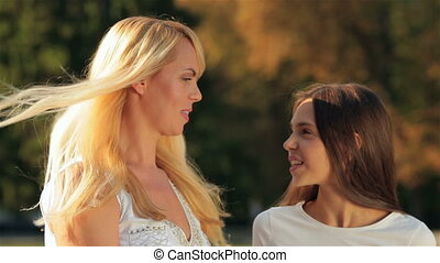 Teenage girl outdoor with her mom