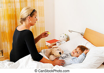 mother and sick child in bed. flu.