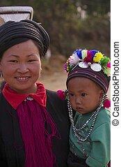 A mother black ethnic Dao Tien