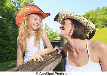 A mother cowgirl with his daughter