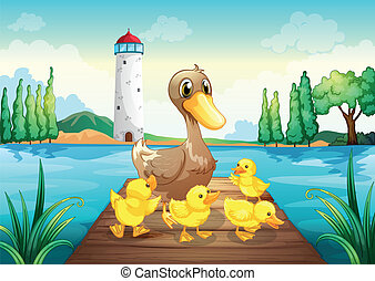 A mother duck with four baby ducks in the wooden bridge