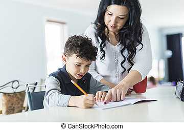 Mother Helping Son for the Homework at home