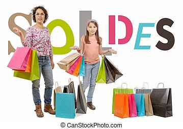 mother is her daughter go shopping during sales