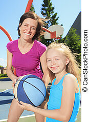 mother play basketball with his daughter
