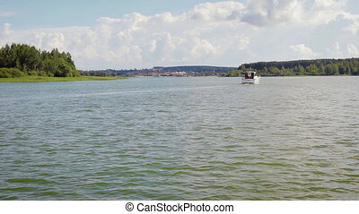 A motor boat with people sailing in the Bay