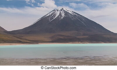 A mountain in front of a river - A close up shot of a tall...