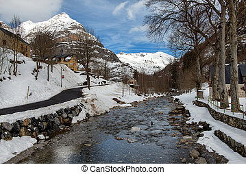 mountain landscape in the snow with a torrent