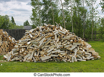 A mountain of chopped firewood for a stove in a village